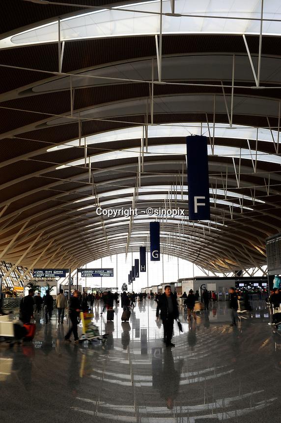 Chinese travelers at Pudong International Airport, Shanghai, China..