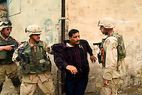 "Baghdad, Iraq, June 2, 2003.US troops often completely misunderstand perfectly benign circumstances for lack of translators and proper training, creating potentially dangerous situations for the Iraqi population they are supposed to protect. Here, a couple of gunshots were fired in the air at the end of a wedding as is customary, US troops parolling the area blocked up a street and tried to break into a house where they wrongly thought the ""shooter"" had taken refuge, the man being arrested and quite brutally treated, is in fact the owner of the house who keenly offered to open it to prove it was empty..."