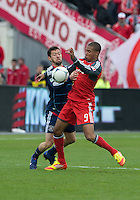 21 April 2012: Toronto FC foward/midfielder Ryan Johnson #9 and Chicago Fire defender Dan Gargan #3 in action during a game between the Chicago Fire and Toronto FC at BMO Field in Toronto..The Chicago Fire won 3-2....