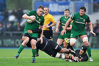 Tom Court of London Irish takes on the Saracens defence. Aviva Premiership match, between Saracens and London Irish on January 3, 2015 at Allianz Park in London, England. Photo by: Patrick Khachfe / JMP