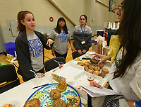 NWA Democrat-Gazette/FLIP PUTTHOFF <br /> BLOOD DRIVE TREATS<br /> Macy Roberts (from left), Mercedes Watson and Dakota Kholos (cq), members of the Rogers High School student council, staff the treats table on Wednesday Nov. 29 2018 at a blood drive organized by the student council with Community Blood Center of the Ozarks. Donors are served refreshments after their donation. The 26 student council members recruited students and teachers to donate, said Roberts, student council president. The next school blood drive is set for March.
