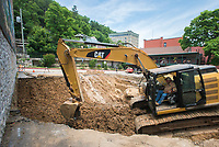 NWA Democrat-Gazette/CHARLIE KAIJO A sinkhole is shown at a parking lot, Friday, June 8, 2018 on Main Street in Eureka Springs.