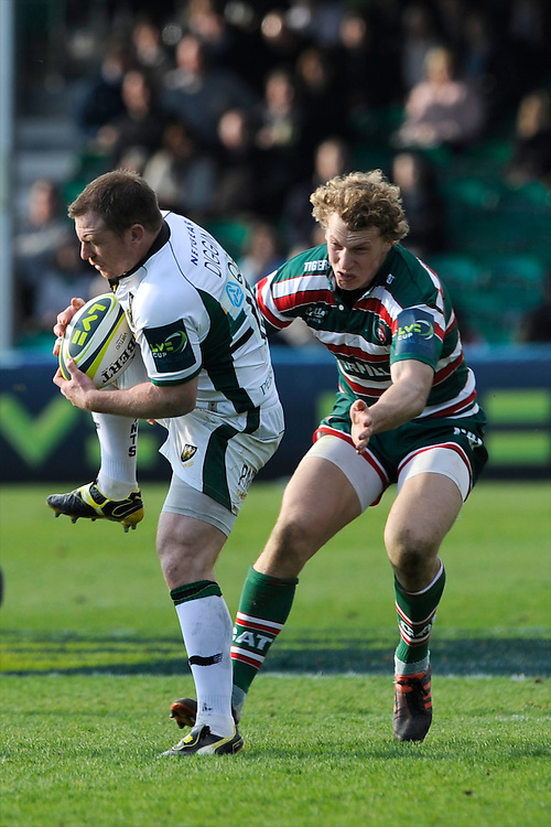 Paul Diggin of Northampton Saints catches the ball as Billy Twelvetrees of Leicester Tigers tackles him during the LV= Cup Final match between Leicester Tigers and Northampton Saints at Sixways Stadium, Worcester on Sunday 18 March 2012 (Photo by Rob Munro, Fotosports International)