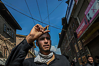 A man holds up a bullet casing he claimed came from the Jammu and Kashmir police during clashes between security forces and local youths during a Muharram procession. Tension were high following protests against the Indian government's decision to revoke article 370 which had given Kashmir a degree of autonomy.