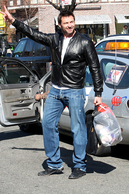 WWW.ACEPIXS.COM . . . . .  ....March 17 2011, New York City....Actor Hugh Jackman struggles to hail a cab in Soho on March 17 2011 in New York City....Please byline: NANCY RIVERA- ACEPIXS.COM.... *** ***..Ace Pictures, Inc:  ..Tel: 646 769 0430..e-mail: info@acepixs.com..web: http://www.acepixs.com