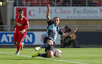 Michael Harriman of Wycombe Wanderers leaps to keep the ball in play during the Sky Bet League 2 match between Leyton Orient and Wycombe Wanderers at the Matchroom Stadium, London, England on 19 September 2015. Photo by Andy Rowland.