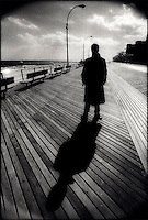 Man & shadow on boardwalk