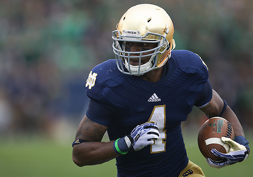 August 31, 2013:  Notre Dame Fighting Irish running back George Atkinson III (4) runs for yardage in the first quarter of NCAA Football game action between the Notre Dame Fighting Irish and the Temple Owls at Notre Dame Stadium in South Bend, Indiana.  Notre Dame defeated Temple 28-6.