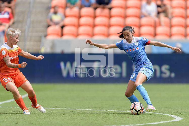 Houston, TX - Saturday April 15, 2017: Christen Press attempts to dribble past Janine van Wyk during a regular season National Women's Soccer League (NWSL) match won by the Houston Dash 2-0 over the Chicago Red Stars at BBVA Compass Stadium.