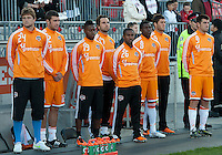 07 May 2011: The Houston Dynamo substitutes stand during the national anthems in an MLS game between the Houston Dynamo and the Toronto FC at BMO Field in Toronto, Ontario..Toronto FC won 2-1.