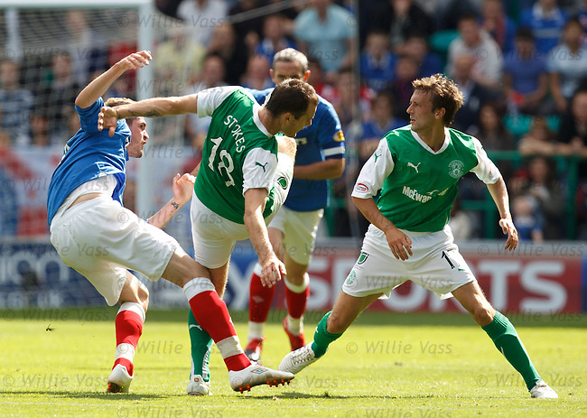 Outraged Kyle Lafferty cuts Anthony Stokes in half as he tries to get to Kevin McBride after he was hit by the ball