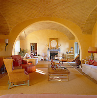 What is now the drawing room once housed the stables and glows from the warmth of yellow distemper on the walls and the gold and orange textiles and furnishings