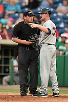 Brevard County Manatees  manager Joe Ayrault (33) asks umpire Kyle Goluba to check with the filed umpire on a call during a game against the Clearwater Threshers on June 28, 2014 at Bright House Field in Clearwater, Florida.  Brevard County defeated Clearwater 6-4.  (Mike Janes/Four Seam Images)