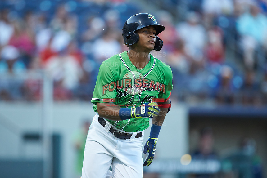 Cristian Pache (15) of the Gwinnett Stripers hustles down the first base line against the Scranton/Wilkes-Barre RailRiders at BB&T BallPark on August 16, 2019 in Lawrenceville, Georgia. The Stripers defeated the RailRiders 5-2. (Brian Westerholt/Four Seam Images)