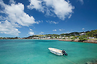 Dinghy with the Thursday Island township in the background.  Thursday Island, Torres Strait Islands, Queensland, Australia