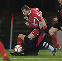 Clyde's Ricki Lamie (black) makes a challenge on Shire's Kevin Turner as he heads towards goal.