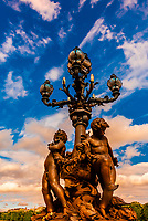 Art nouveau lamps adorned with cherubs, Pont Alexandre III (bridge). It is the most ornate bridge in Paris. Paris, France.