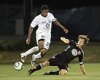 Carey Talley #8 of D.C. United slides the ball away from Sheanon Williams #20 of the Harrisburg City Islanders during a US Open Cup match at the Maryland Soccerplex on July 21 2010, in Boyds, Maryland. United won 2-0.