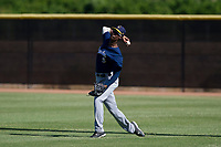 Milwaukee Brewers outfielder Je'Von Ward (5) attempts to throw a runner out at third base during an Instructional League game against the San Diego Padres on September 27, 2017 at Peoria Sports Complex in Peoria, Arizona. (Zachary Lucy/Four Seam Images)