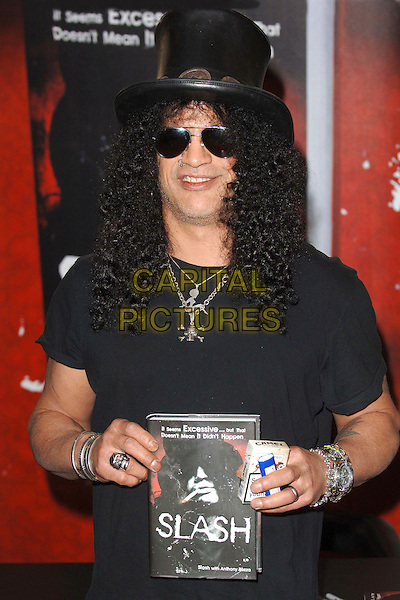 "SLASH - SAUL HUDSON .Slash of Guns N Roses, signs copies of his autobiography entitled ""Slash"" at Waterstones, Picadilly, London, England, 21st November 2007..Book Signing half length black hat sunglasses necklaces t-shirt cigarettes lighter.CAP/ BEL.©Tom Belcher/Capital Pictures."
