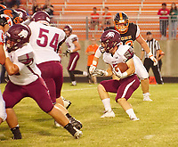 Photo by Randy Moll<br /> With Gravette's defensive end, Seth Spencer, closing in, Lincoln's Jacob Anderson looks for running room during the Friday, Sept. 22, 2017, game at Gravette.