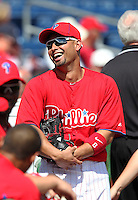Philadelphia Phillies outfielder Shane Victorino #8 in the dugout before a scrimmage against the Florida State Seminoles at Brighthouse Field on February 29, 2012 in Clearwater, Florida.  Philadelphia defeated Florida State 6-1.  (Mike Janes/Four Seam Images)
