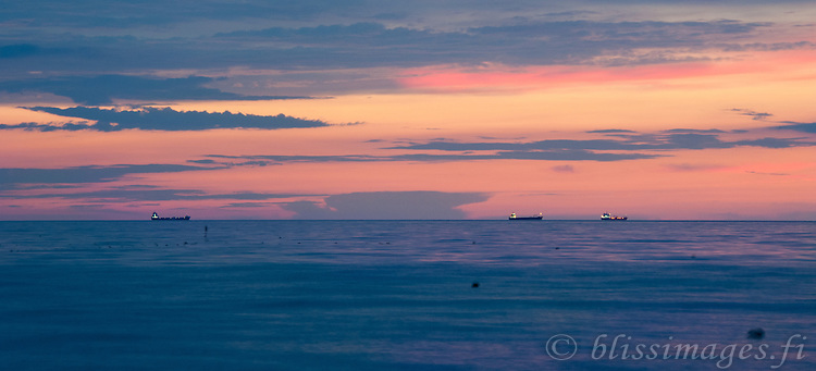 Ships anchored in the Gulf of Riga at sunset off Latvia's capital, Riga.