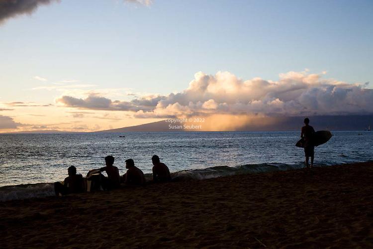 Skimboarders on the beach at Kaanapali, Maui, Hawaii, USA
