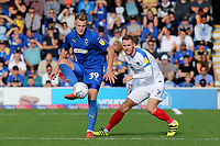 Joe Pigott of AFC Wimbledon in action as Portsmouth's Tom Naylor looks on during AFC Wimbledon vs Portsmouth, Sky Bet EFL League 1 Football at the Cherry Red Records Stadium on 13th October 2018