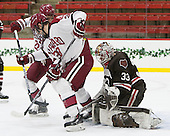 Devin Tringale (Harvard - 22), Brian Hart (Harvard - 39), Tim Ernst (Brown - 33) - The Harvard University Crimson defeated the Brown University Bears 4-3 to sweep their first round match up in the ECAC playoffs on Saturday, March 7, 2015, at Bright-Landry Hockey Center in Cambridge, Massachusetts.
