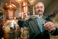 Tiroler Oberland, Tyrol, Austria, June 2009. Gerhard Maass tastes his award winning schnaps in his Feindistillerie Turabauer distillery. The Region of the Tyrolian Highlands offer many different options for outdoor adventures, leisure and relaxing. Photo by Frits Meyst/Adventure4ever.com