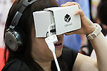 A visitor wears a 360 virtual reality goggles at the Tokyo Gift Show exhibition on September 7, 2016, Tokyo, Japan. The 82nd Tokyo International Gift Show Autumn 2016 exhibition introduced Japanese and international goods from 2,729 companies, 686 of which came from 19 different countries outside of Japan, over three days from September 7th to 9th at Tokyo Big Sight. (Photo by Rodrigo Reyes Marin/AFLO)