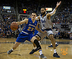 South Dakota State guard Owen King (23) drives past Nevada's Cody Martin (11) in the second half of an NCAA college basketball game in Reno, Nev., Saturday, Dec. 15, 2018. (AP Photo/Tom R. Smedes)