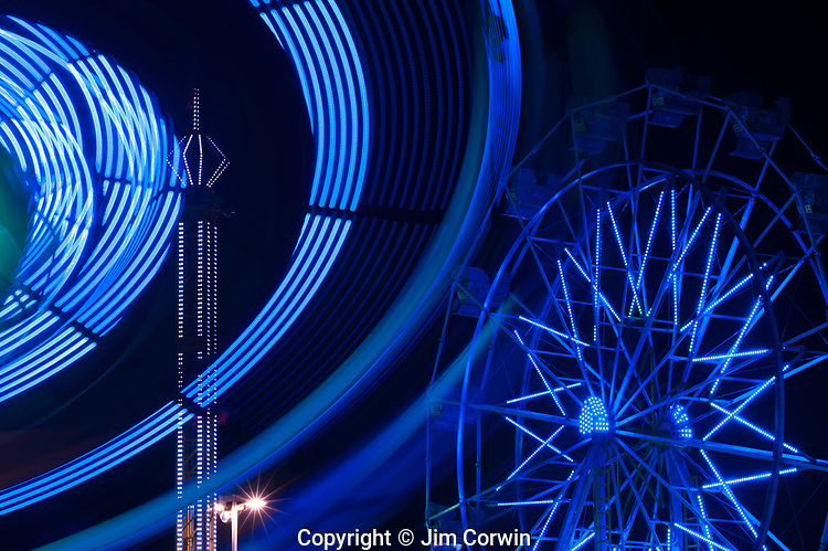 Ferris wheel in motion with  abstract patterns of colors