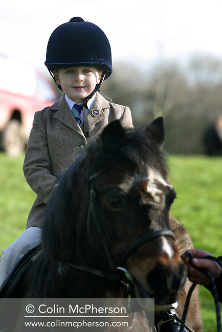 A young girl joins the Wynnstay Hunt before they ride out for a day's foxhunting (she does not ride out with them). The Wynnstay Hunt, named after Sir Watkin Williams-Wynn, dated back to the 18th century and hunted on country estates in Shropshire, Cheshire and north Wales. Hunting with dogs in England and Wales became illegal on 18th February 2005 despite legal challenges to the ban and many hunts vowed to continue the ancient sport of foxhunting, risking prosecution.