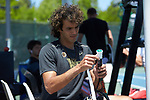 Skander Mansouri of the Wake Forest Demon Deacons re-grips his racket prior to the match against the North Carolina Tar Heels at the 2018 ACC Men's Tennis Championship at the Cary Tennis Center on April 29, 2018 in Cary, North Carolina.  The Demon Deacons defeated the Tar Heels 4-0.  (Brian Westerholt/Sports On Film)