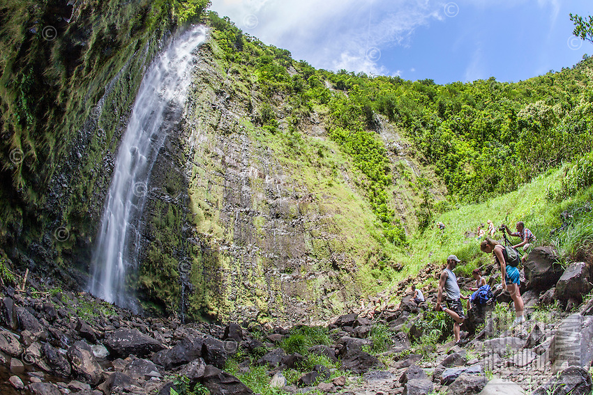 Hikers viewing Waimoku Falls waterfall, Pipiwai hiking trail, Haleakala National Park, Kipahulu, Maui