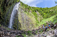 Hikers viewing Waimoku Falls waterfall, Pipiwai hiking trail, Haleakala National Park, Kipahulu, Maui