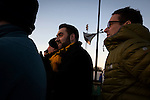 Home sup[porters watching the first-half action at Lye Meadow as Alvechurch (in amber) hosted Highgate United in a Midland Football League premier division match. Originally founded in 1929 and reformed in 1996 after going bust, the club has plans to move from their current historic ground to a new purpose-built stadium in time for the 2017-18 season. Alvechurch won this particular match by 3-0, watched by 178 spectators, taking them back to the top of the league.
