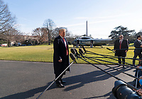 United States President Donald J. Trump speaks to the media upon his return to the White House in Washington, DC after a day trip to Camp David on Sunday, January 6, 2019.<br /> CAP/MPI/RS<br /> &copy;RS/MPI/Capital Pictures