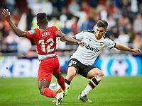 9th November 2019; Mestalla, Valencia, Spain; La Liga Football,Valencia versus Granada; Ramon Azeez of Granada tackles Ferran Torres of Valencia CF - Editorial Use