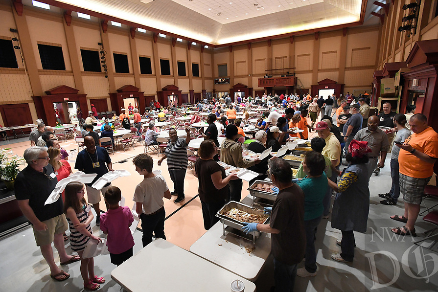 NWA Democrat-Gazette/J.T. WAMPLER Guests line up for plates of home-cooked food Saturday April 15, 2017 at the Annual M&N Augustine Foundation Easter Feed at Central United Methodist Church in Fayetteville. The foundation feeds an estimated 6,000 people during annual event. The Easter Feed started nearly 20 years ago when Merlin Augustine and the Augustine family decided to expand their annual Easter dinner to include members of the community.
