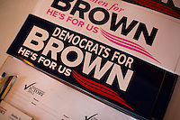 "Bumper stickers reading ""Democrats for Brown / He's for us"" laySenator Scott Brown (R-MA) lay on a table at a constituent lunch at Bella Costa Restaurant in Framingham, Massachusetts, USA, on Thurs., Nov. 2, 2012. Senator Scott Brown is seeking re-election to the Senate.  His opponent is Elizabeth Warren, a democrat."
