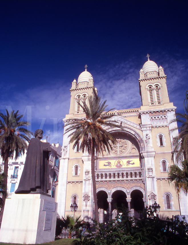 Tunis. The 19th century Cathedral of St Vincent de Paul and statue of Ibn Khaldun (Islamic philosopher).Tunisia. North Africa.
