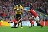 Tevita Kuridrani of Australia is tackled by Dan Biggar and Jamie Roberts of Wales during Match 35 of the Rugby World Cup 2015 between Australia and Wales - 10/10/2015 - Twickenham Stadium, London<br /> Mandatory Credit: Rob Munro/Stewart Communications
