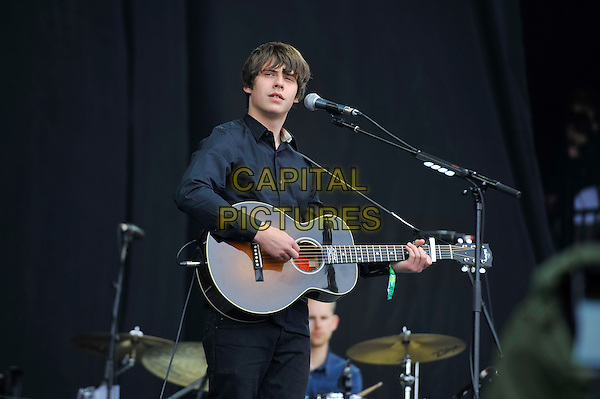 Jake Bugg<br /> performing at Glastonbury Festival, Worthy Farm, Pilton, Somerset, <br /> England, UK, 28th June 2013.<br /> live on stage music concert gig half length playing guitar microphone navy blue black shirt <br /> CAP/MAR<br /> &copy; Martin Harris/Capital Pictures