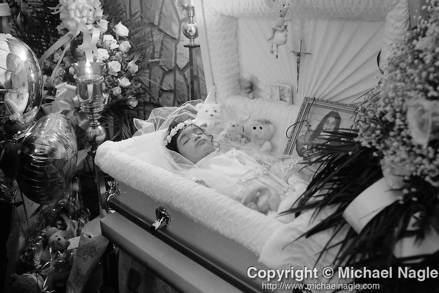 NEW YORK - JANUARY 16: Nixzmary Brown's body rests in her casket at the Ortiz funeral home during her wake on January 16, 2006, in New York City.  Nixmary was murdered by her stepfather.  (PHOTOGRAPH BY MICHAEL NAGLE)