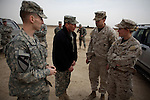Iraq commander General David Petraeus inspects the work of Army Special Forces soldiers training potential Iraqi S.W.A.T. police officers at Camp Echo in ad-Diwaniyah. The visit was took place during a visit by Petraeus -   and his immediate subordinate Lt. General Raymond Odierno - to attend a change of command ceremony for rotating Polish units in ad-Diwaniyah, a majority Shiia city in southern Iraq. The incoming Polish unit will be the last Polish force to serve in Iraq after Warsaw announced plans to withdraw its troops in the fall. The Polish have third largest national contingent serving in Iraq after the US and Great Britain.