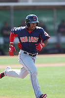 Francisco Lindor #12 of the Cleveland Indians runs to first base during a Minor League Spring Training Game against the Cincinnati Reds at the Cincinnati Reds Spring Training Complex on March 25, 2014 in Goodyear, Arizona. (Larry Goren/Four Seam Images)
