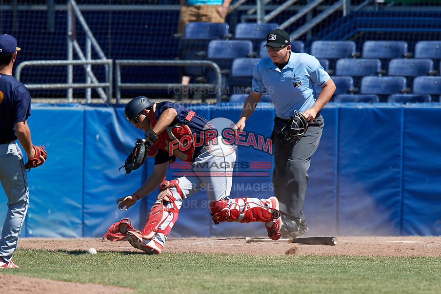 State College Spikes catcher Joe Gomez (25) fields a bunt as umpire Jordan Sandberg looks on during a game against the Batavia Muckdogs on July 8, 2018 at Dwyer Stadium in Batavia, New York.  Batavia defeated State College 8-3.  (Mike Janes/Four Seam Images)